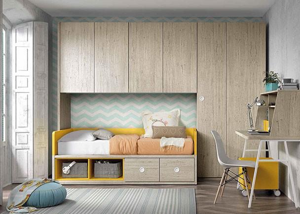 Habitación infantil equipada con una novedosa cama nido con dos grandes contenedores y dos huecos diáfanos en su base. El ambiente cuenta con un a