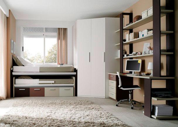 <p>Dormitorio Juvenil con compacto con cama desplazable y cajones con guías, armario rinconero, escritorio con cajonera y librería a medida con columnas frontales.</p>