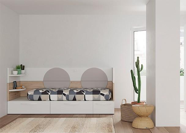 <p>Juvenil con cama modular con base de 3 cajones. El arrimadero de pared est&aacute; compuesto por paneles ensamblables con y sin estante. Como complementos se han incluidos unos tapizados en arco a modo de chichonera.</p>