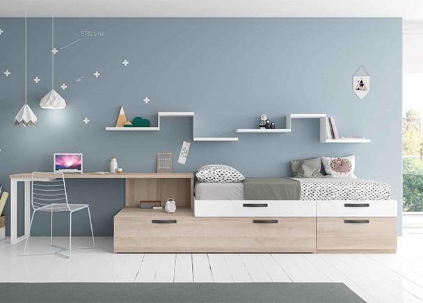 Dormitorio juvenil equipado a base de módulos de gran capacidad de almacenamiento de diferentes anchos.