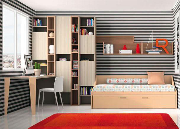 <p>Habitación juvenil con cama nido con arrastre.</p> <p></p> <p>Sobre la pared, se han colgado unos módulos diáfanos de distintas medidas.</p> <p></p> <p>Junto a la cama, hemos realizado un juego de volumenes, gracias al modelo de libreria escogido.<br />Nos permite disponer de distintos anchos e incorporar puertas para cubrir algunos de los huecos, resultando un conjunto dinámico y original.<br />La zona de estudio la forma una encimera de 220 apoyada sobre unas patas.</p>