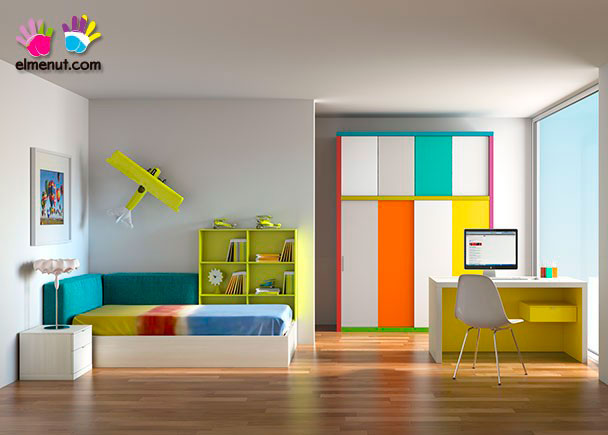 Habitación infantil en la que la simplicidad de lineas y el color son los grandes protagonistas.