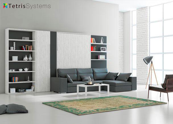 <p>Salón DIVO con librerías y cama abatible de 150 x 200 con sofá de asientos elevables y módulo chaise longue con arcón trasero.</p>