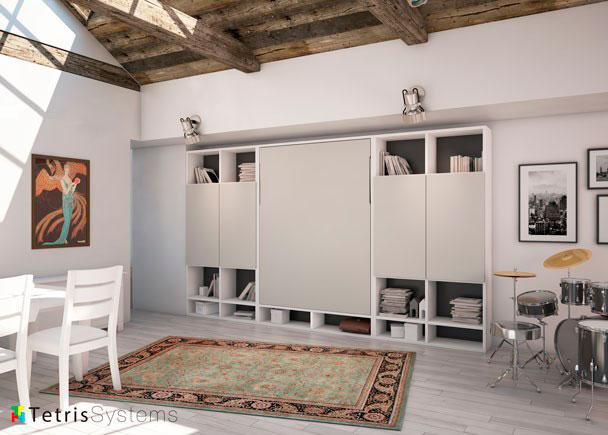 <p>Salón con cama abatible vertical para colchón de 150 x 190. La composición mural está integrada por dos 4 librerías (dos a cada lado) y una cama WALLBED en la parte central, todo dispuesto de manera muy simétrica y siguiendo unas pautas de distribución contemporánea.</p>
