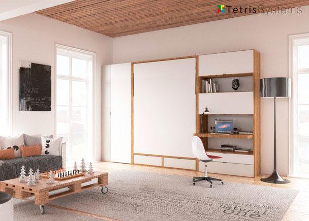 <p>Salón con cama abatible vertical de matrimonio serie WALLBED, para somier de 150 x 190. El ambiente cuenta con un escritorio y unos módulos de puerta elevable colgados de manera intercalada, de modo que el espacio entre ellos pueda ser aprovechado como librería y un armario terminal de 90 cm.</p>