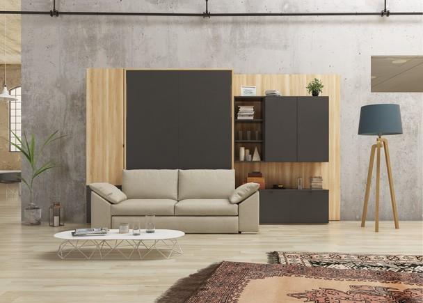 Salón comedor equipado con una cama abatible vertical de matrimonio con sofá de la serie DIVO, para colchón de 150 x 190, con brazos en ing