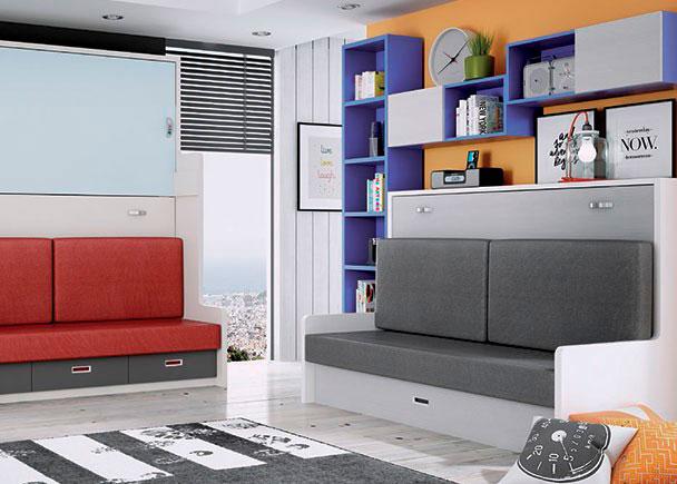 <p>Cama abatible de 90 x 190 con sofá y arrastre nido. La composición mural queda integrada por una librería de 238.5 cm de altura y una serie de cubos diafanos y con puertas alternados.</p>
