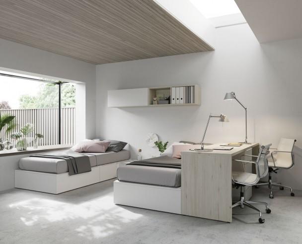 <p>Habitaci&oacute;n infantil con 2 camas compuestas a base de m&oacute;dulos y escritorio.</p>