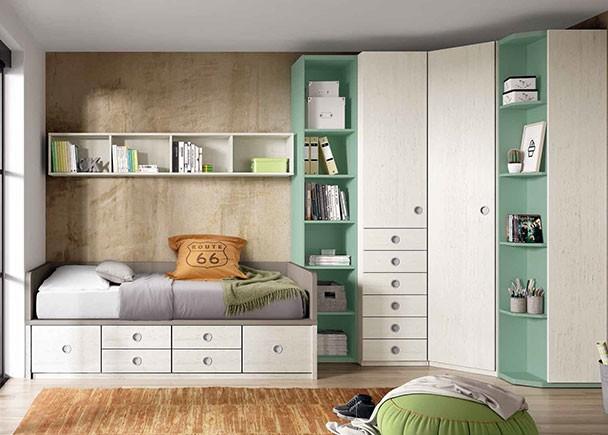 Dormitorio juvenil con armario rinconero con sinfonier de cajones vistos, puerta en chaflán y terminal zapatero con estantes. Para la zona de descanso se