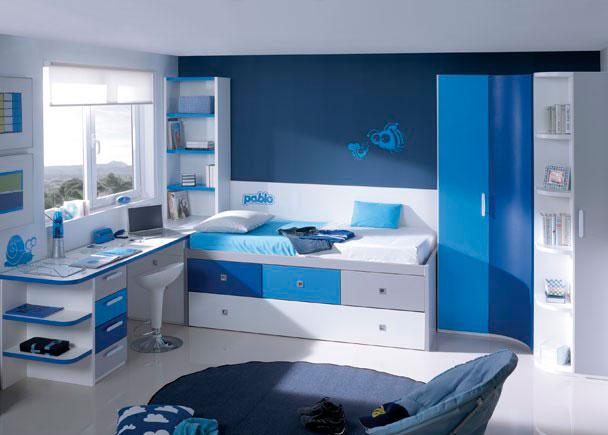 Habitación infantil con compacto nido de cajones con arrastre + armario de rincón curvo con terminal zapatero y escritorio.