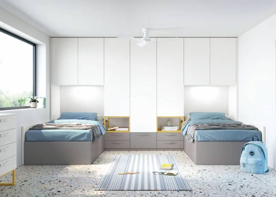<p>Dormitorio infantil con dos camas gemelas con m&oacute;dulo central de cajones y altillos con armarios. Este dise&ntilde;o ofrece gran capacidad de almacenaje gracias a la gran cantidad de armarios altillos. Como complementos, un sinfonier y un espejo mural ovalado.</p>