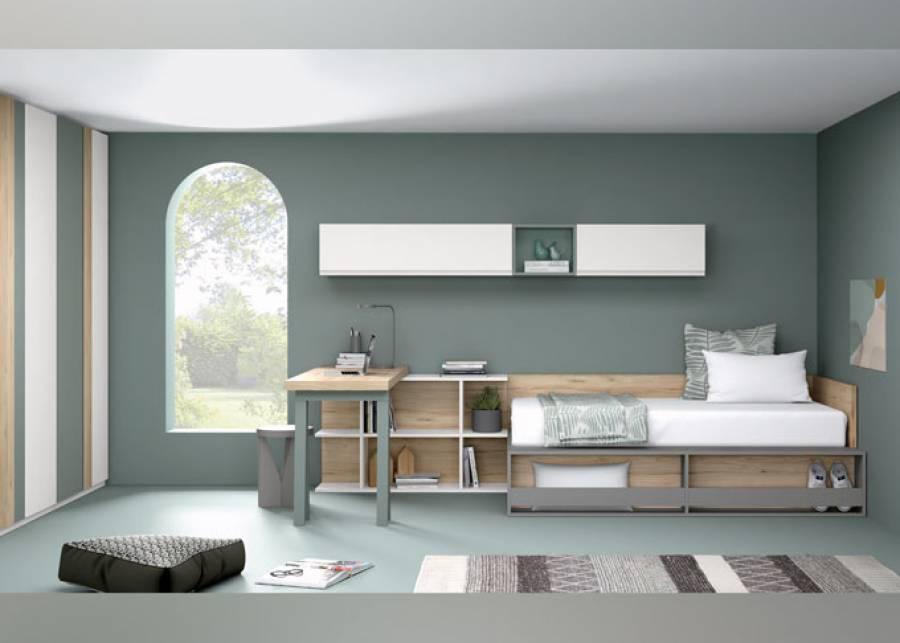 Propuesta de habitación juvenil pensada para albergar zona de descanso, zona de estudio y zona de almacenaje. La estantería frontal para cama resu