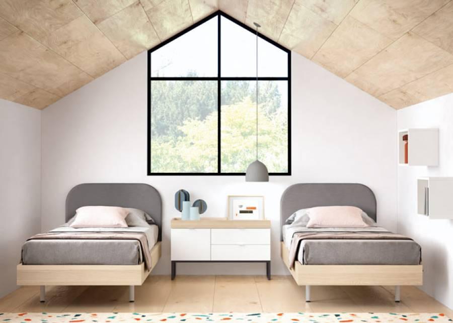 Espacio juvenil en el que se presentan dos camas individuales Cotton con cabecero tapizado desenfundable, que consiguen un ambiente cálido y acogedor. Un
