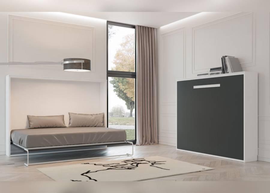 Ambiente polivalente, equipado con dos camas abatibles de matrimonio en versión horizontal, para medida de colchón de 150 x 190. La estructura de