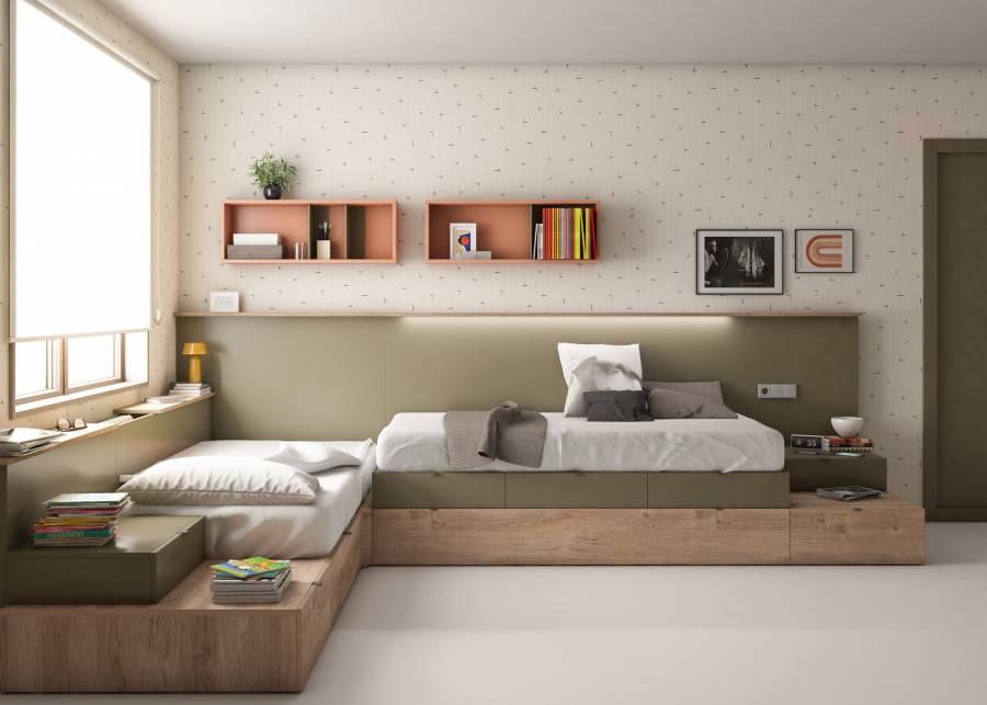 <h2>&iexcl;Una habitaci&oacute;n compartida!</h2> <p>Esta <strong>habitaci&oacute;n modular </strong>con<strong> dos camas dispuestas en L</strong>, resulta divertida, ya que est&aacute; pensada para dos hermanos, pero con la posibilidad de que se pueda quedar perfectamente, alg&uacute;n amiguito a dormir en casa, ya que una de las camas dispone de una<strong> cama extra con arrastre nido. </strong>La repisa situada bajo la ventana, es un rinconcito que a los ni&ntilde;os les encanta. Ellos lo utilizan como grada durante sus juegos, pero tambi&eacute;n se sientan all&iacute; a leer o mirar por la ventana. &nbsp;</p>